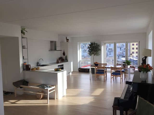 Bright room in large, modern apartement.