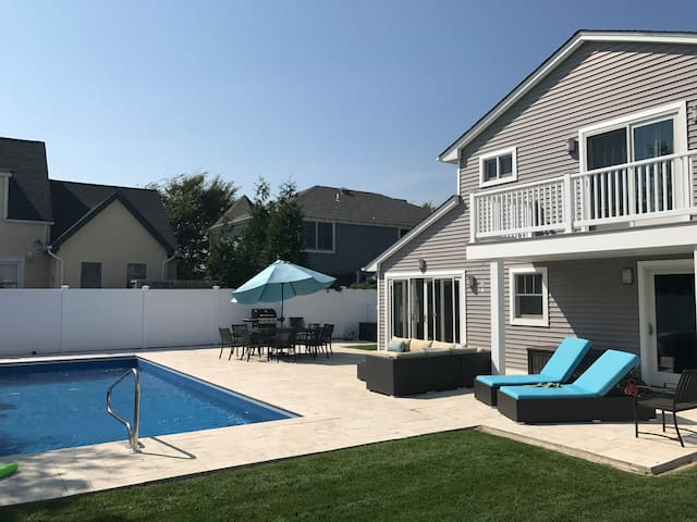 Newly landscaped yard and comfortable seating and lounging options