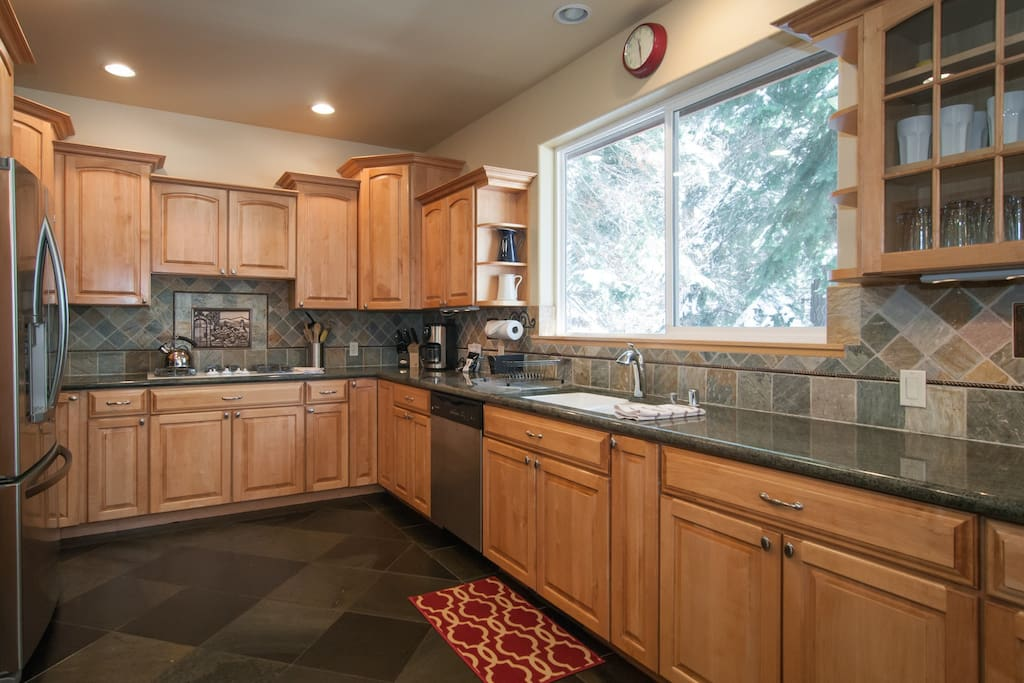 beautifully done large kitchen with granite counters, walk in pantry