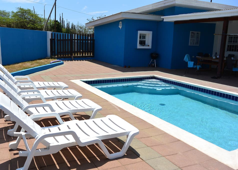 Private pool  with large terrace, sunbeds and covered porch with dining table