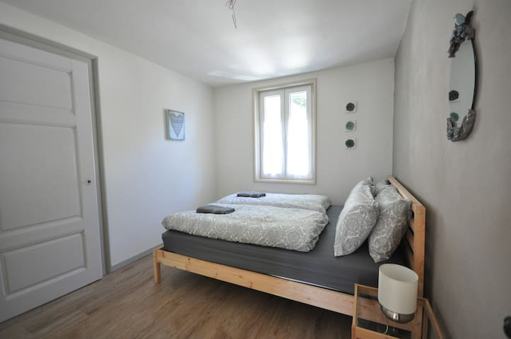 Upstairs comfortable double with wardrobe. Leading to small twin
