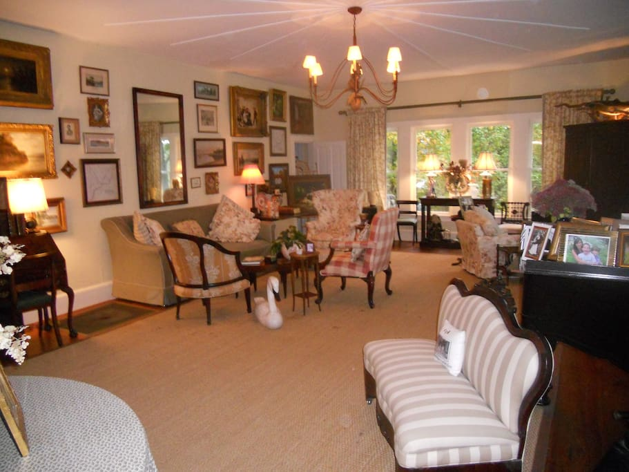 The spacious living room with grand piano.