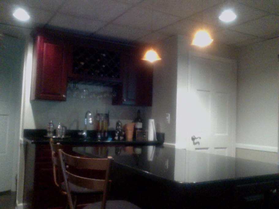 Newly renovated kitchenette with small fridge, sink, double burner and microwave.