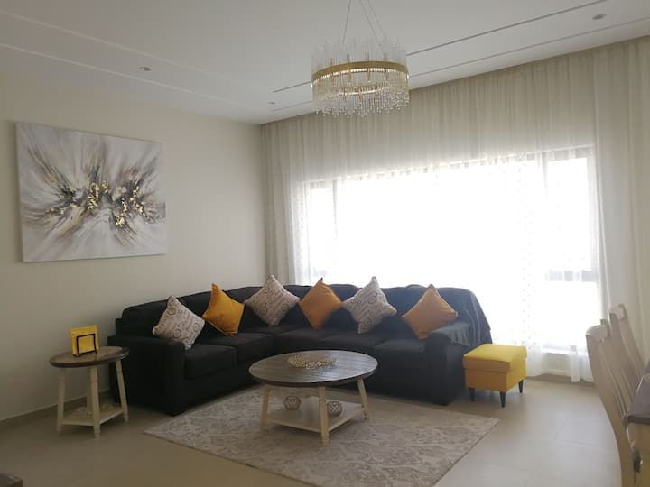 Its in manama. Quite area. All facilities availabe