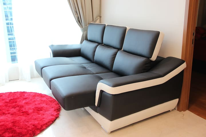 Expandable leather sofa bed