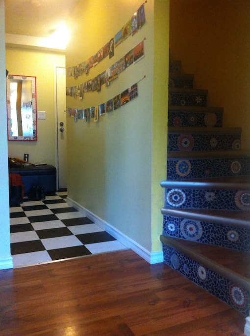 Main floor entry with mosaic staircase
