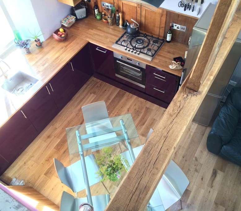 the kitchen and glass dining table viewed from the mezzanine