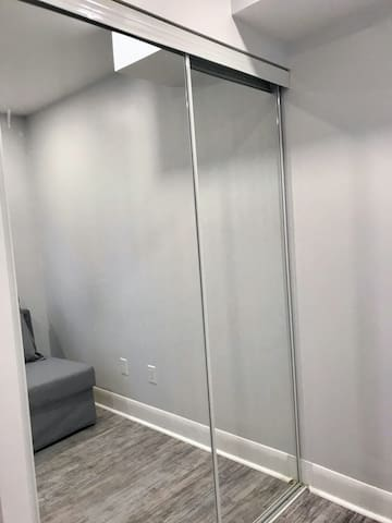Shared closet in guest bedroom