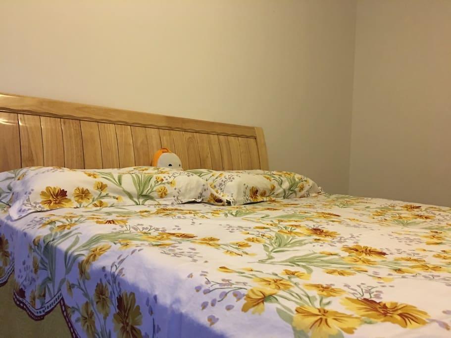 Wood queen-size bed