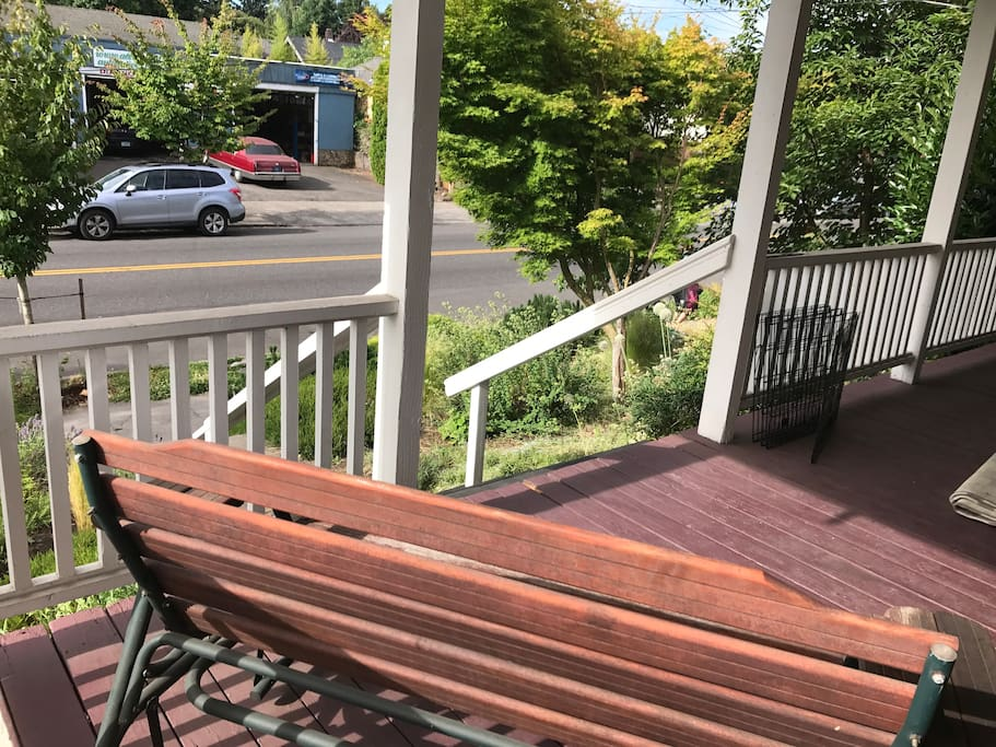 Lovely porch glide perfect for wine and people watching