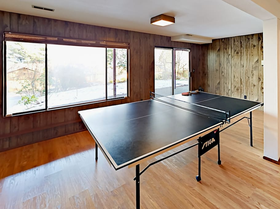 Hang out in the game room equipped with a ping pong table and badminton net.