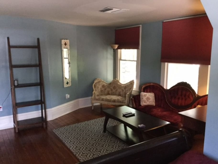 Living area with additional full sized sleigh bed.  Bluetooth speaker, USBs, internet for your convenience.