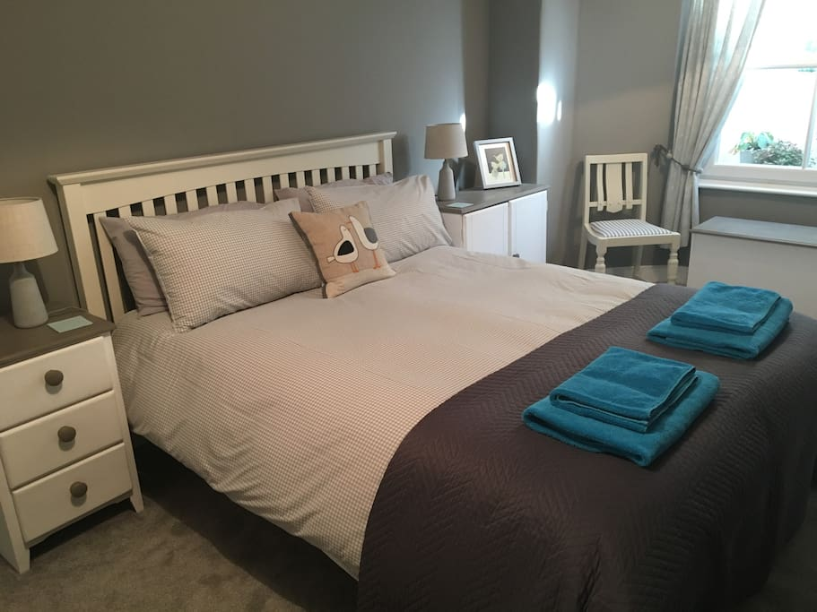 Spacious main bedroom with king size bed and plenty of storage
