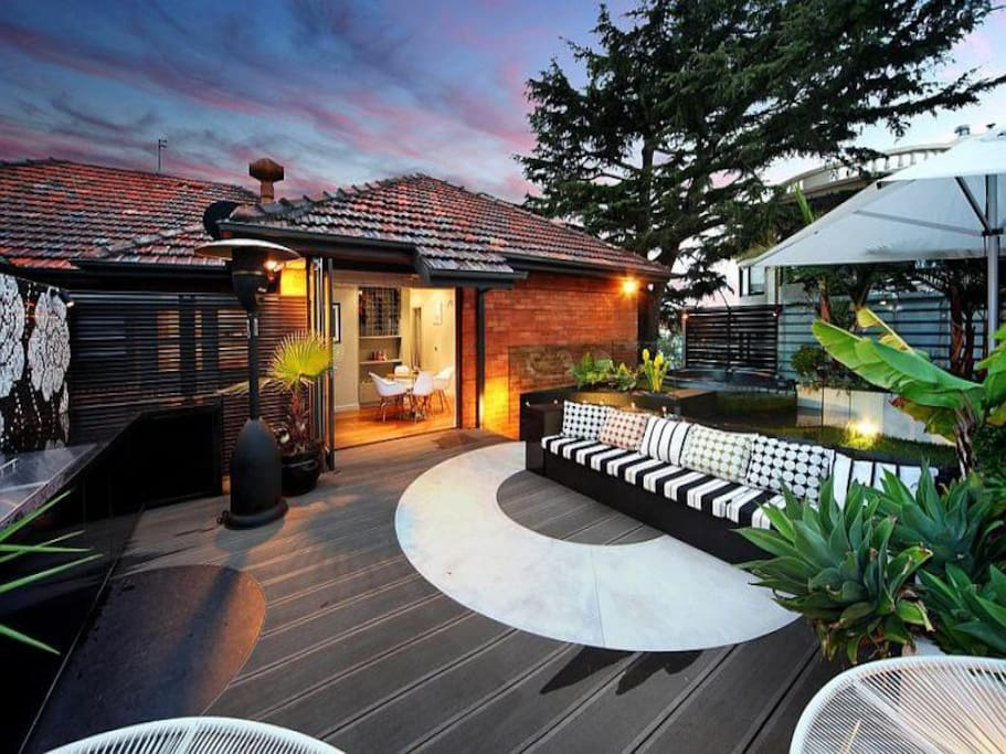Huge entertaining deck with extensive outdoor kitchen, Weber Q BBQ, Spa, and Large lounge.