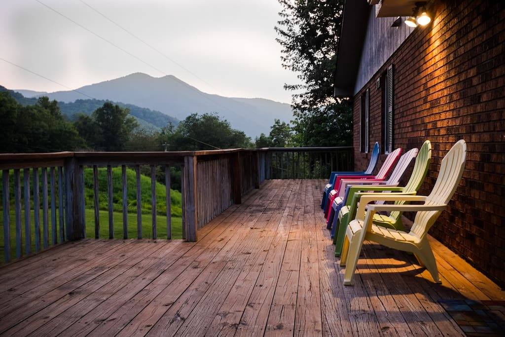 Relax after a long day with a drink or book (or both!) in a comfortable mountain Summer