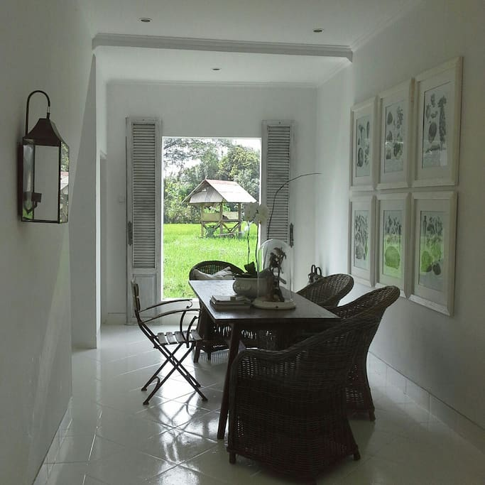 Dining and pantry area overlooking private garden and padi fields