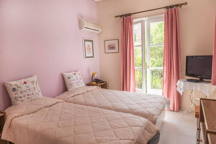 The pink bedroom, sweet and comfortable.