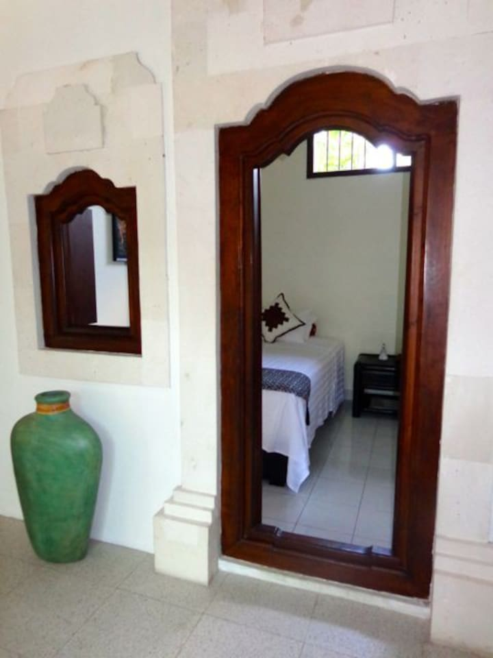 Traditional Balinese doors & windows to the Jepun (2nd inside bedroom) with AC, Fan with 1 double bed + 1 single bed & ensuite bathroom