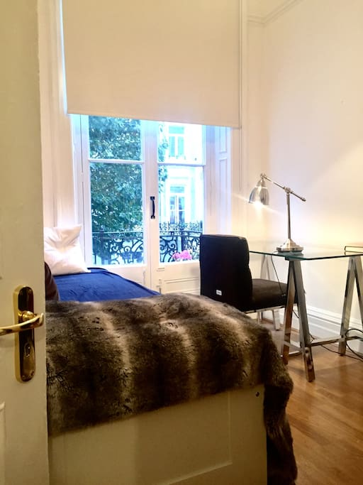Small bedroom with designer desk, and chair and private access to balcony (daybed unfolds into a double bed)