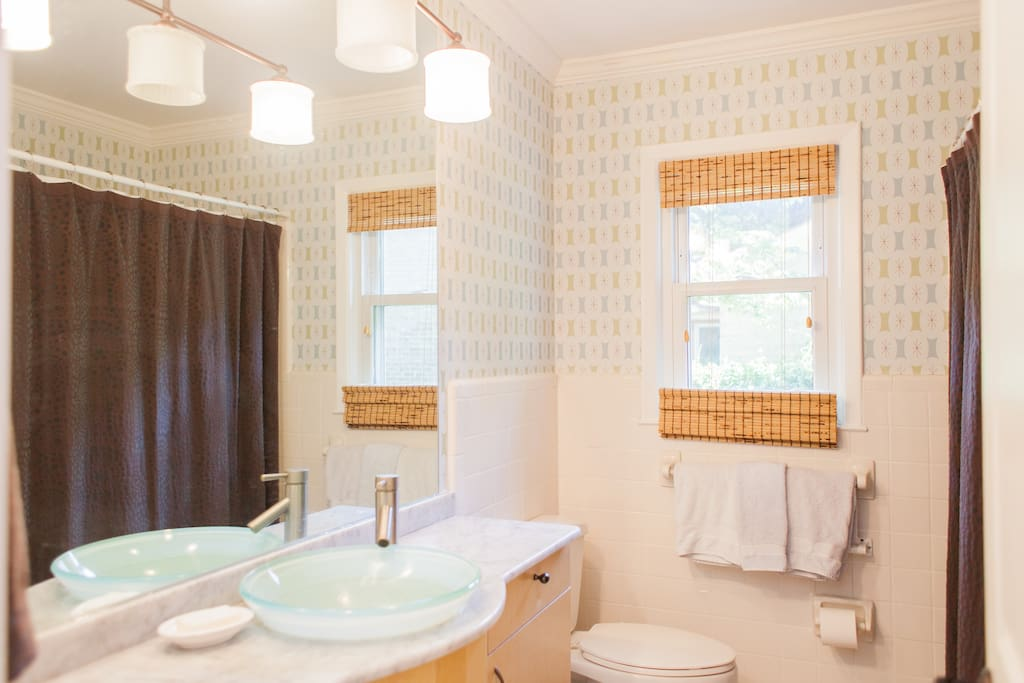 Downstairs guests have exclusive use of the hall bath next door with tub and shower.
