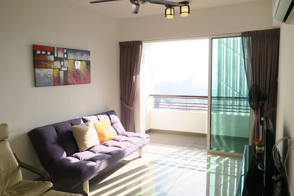 Bright and airy living room and balcony with a breathtaking view of the Titiwangsa mountains.