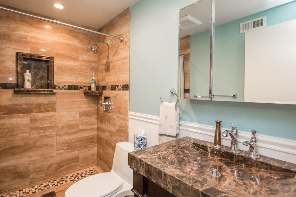private bathroom, Walnut Travertine and Emperador Marble sink and accents