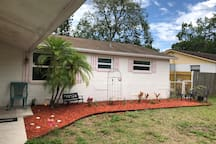 Front of our home,  covered walkway, security camera, private keypad lock entry, with table and chairs.