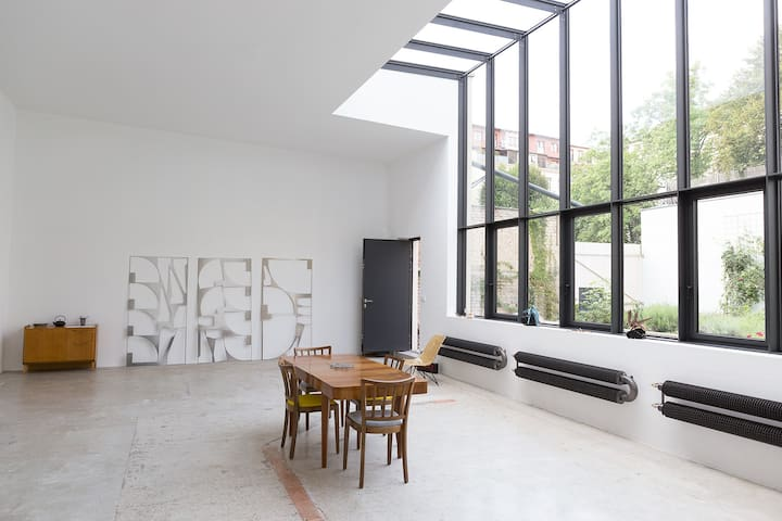 Loft with private garden in the city center