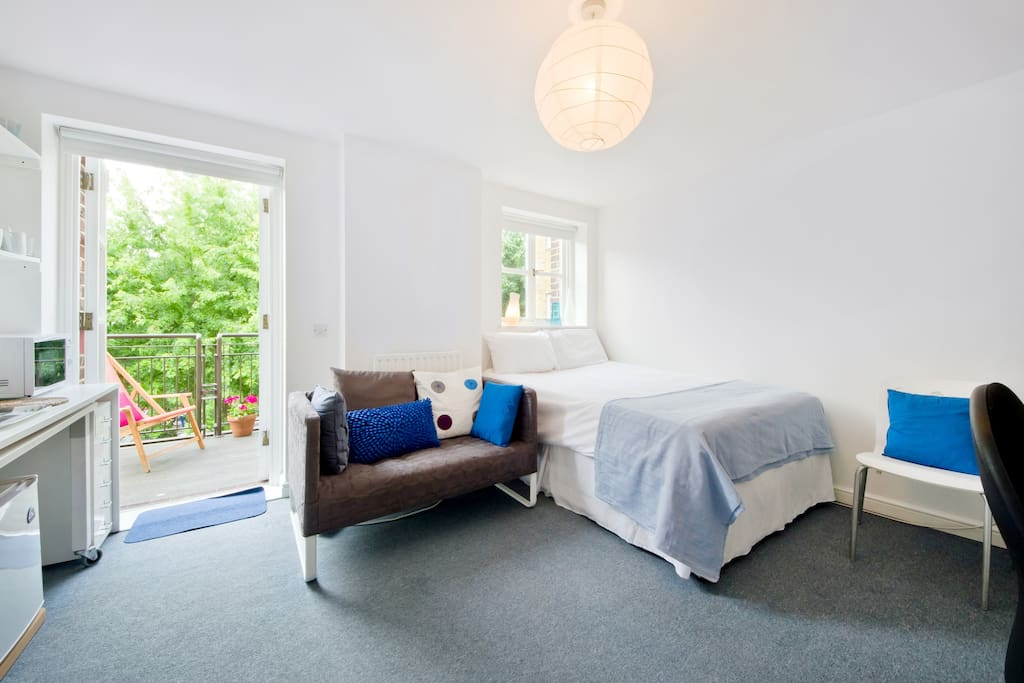 The main master bedroom with double bed and sofa