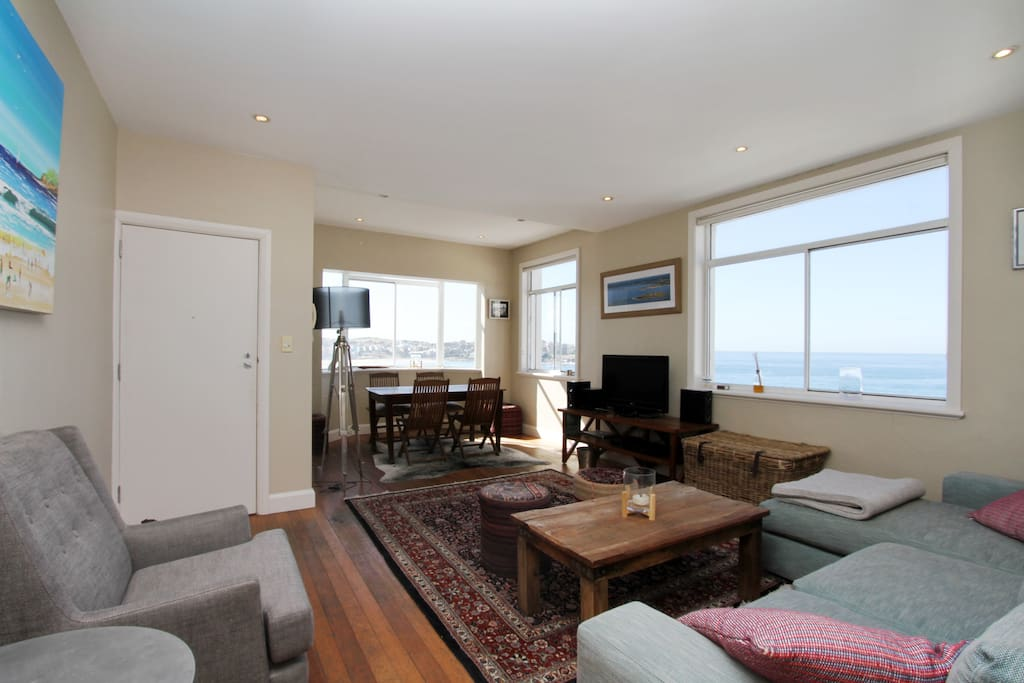 Living room with panoramic ocean views- note we now have a new bigger TV mounted on the wall (shown in other photos)