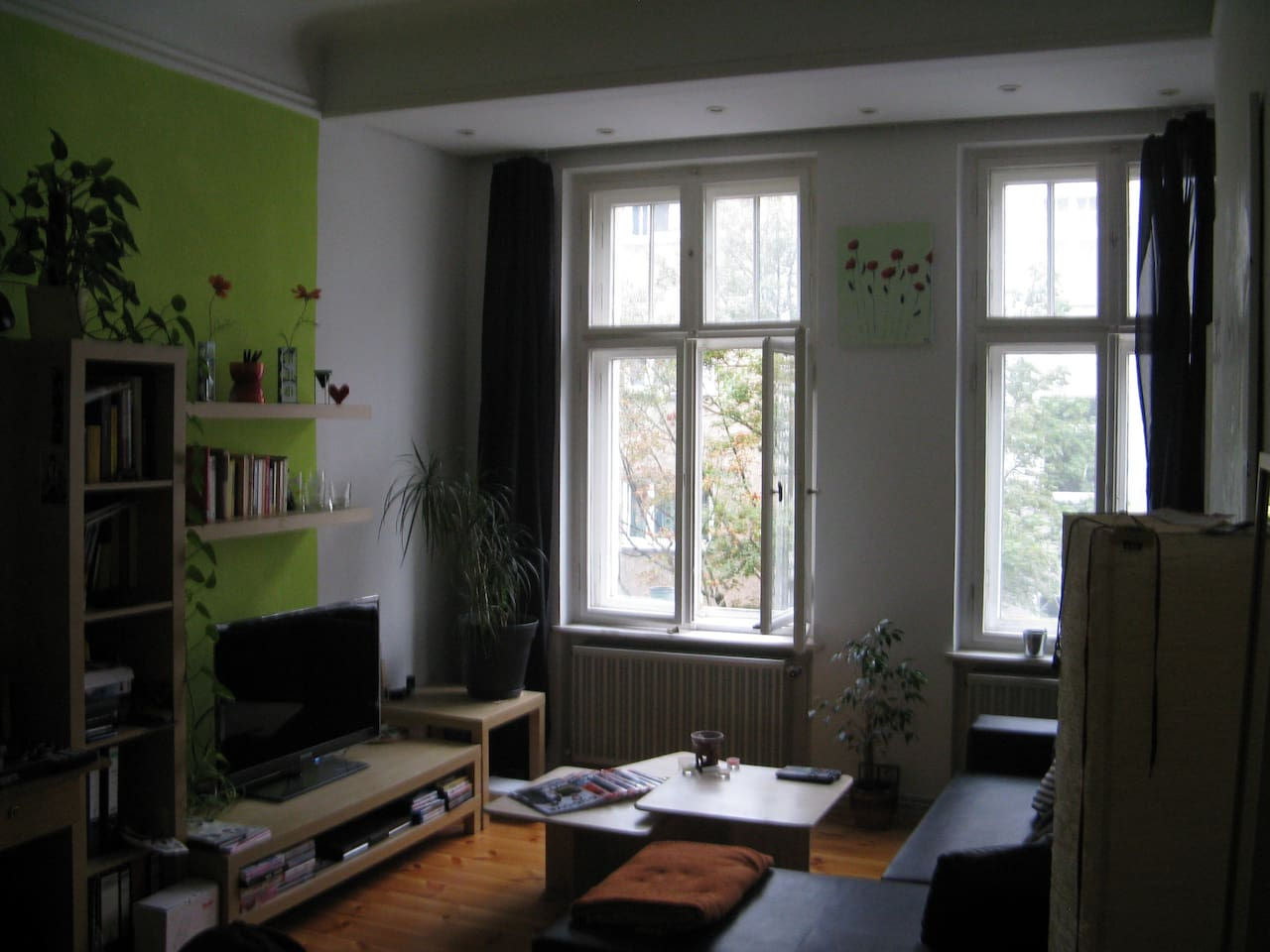 Seating area of the room, big windows