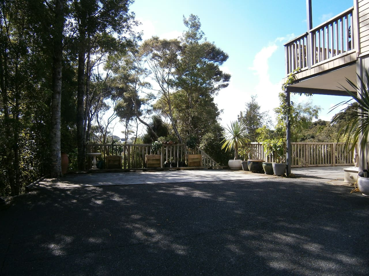 Off street, private and secure guest parking area - yes it's wood and yes you can park there!