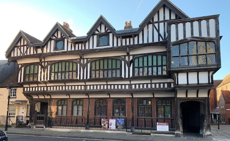 Tudor House to the rear of the property, Grade 1 listed and is now a museum