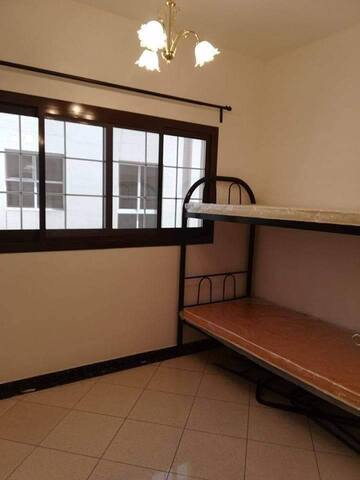 Inside Room up to ceiling with own door and light. Near Sharaf DG metro and Mall of the Emirates. Accessible to restaurants and hotels