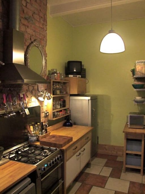 Exposed brick wall; free-standing units; fridge freezer;