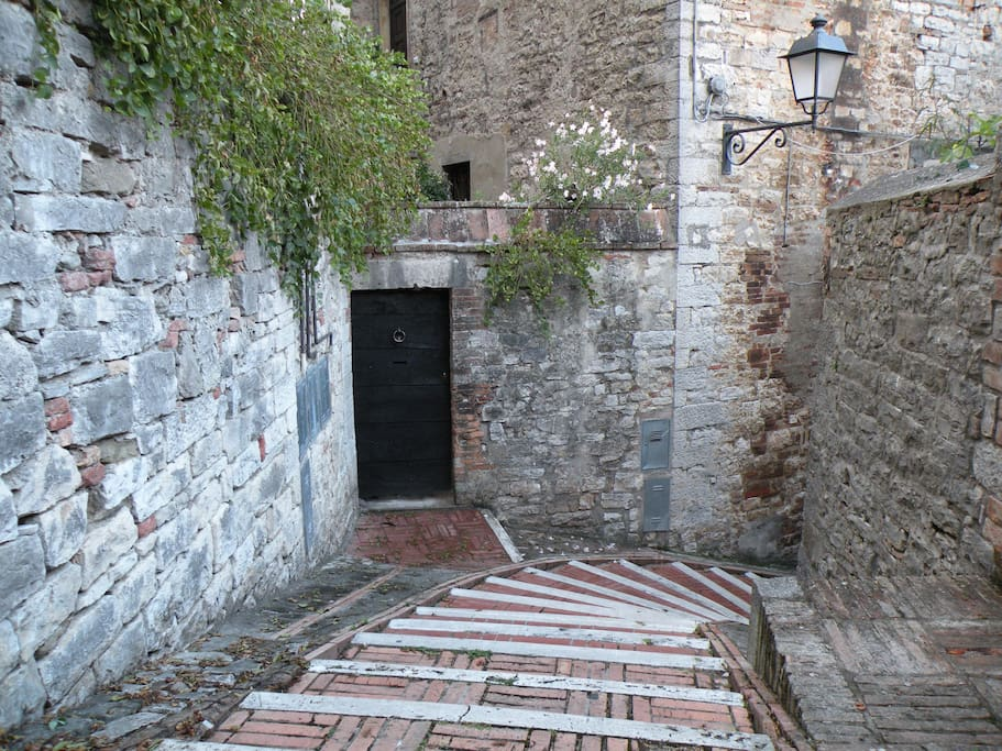 The original door welcomes you as you walk down from Todi center