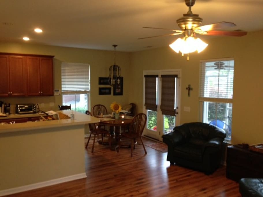 The connected living, dining, and kitchen area comfortably accommodates 8 people.