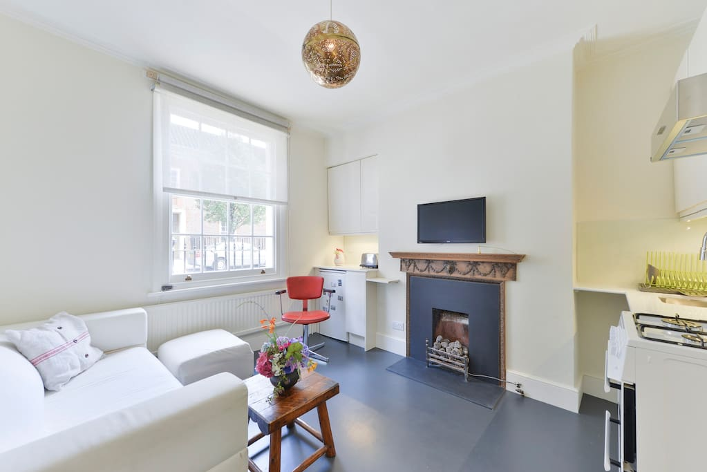 Living room/kitchen with Sky TV