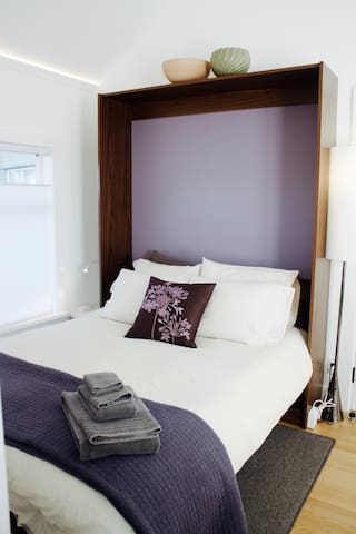 Brand new comfortable queen bed. Beside USB chargers provided.