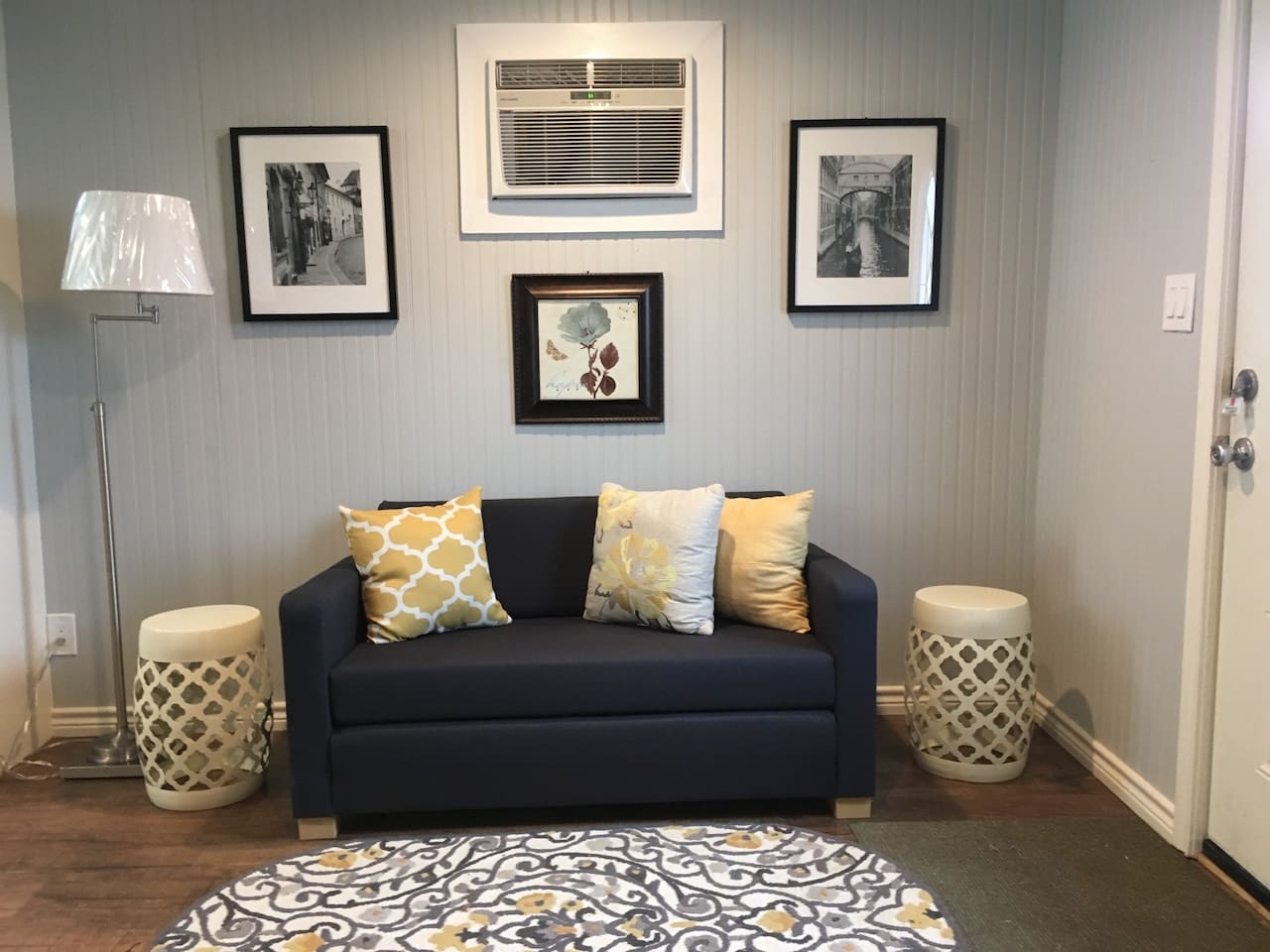 Cute and welcoming living area with TV. The couch extends into a floor bed to accommodate extra guests.