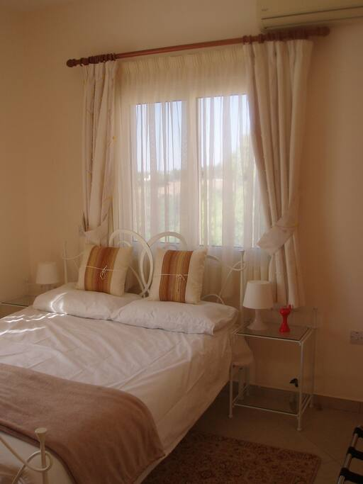 Double bed, en-suite shower room with WC, and large sunny balcony overlooking stunning rolling hills and valleys
