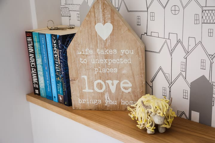 Take time out to read a book or why not add to the collection and leave one for future guests?