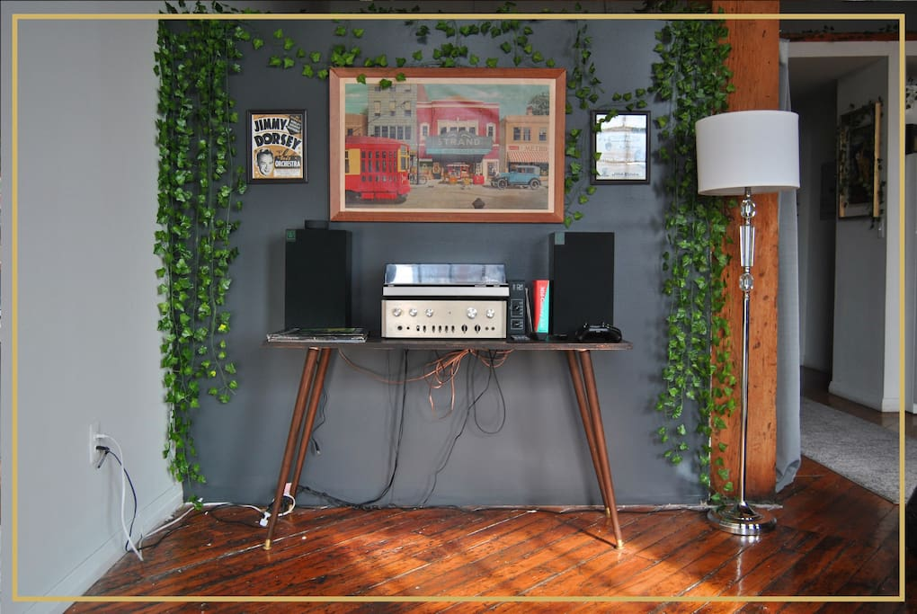 Record player with select vinyls for each reservation. *The wires have since been hidden!
