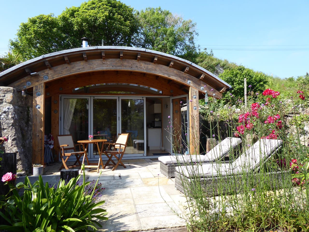 The Sea Breeze Beach House ( Eco Coastal Cabin) in its own south facing private walled garden a seven minute stroll to the beach and the stunning Pembrokeshire Coast in the charming coastal village of Manorbier, 15 minutes drive away fromTenby.