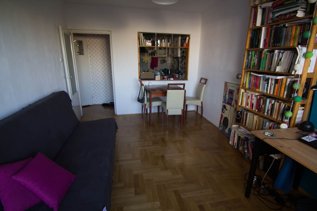 """Living room with the """"window"""" to the kitchen"""