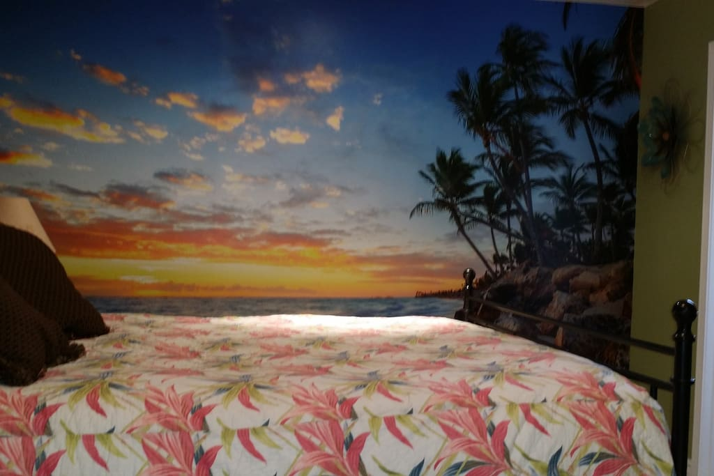 Queen size Bed with a beach mural to fall asleep too