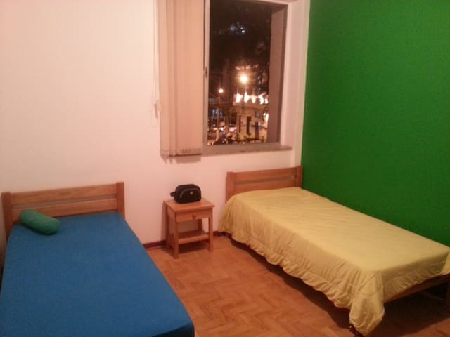 The green room has two single beds.