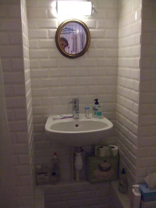 small and efficient bathroom. metro tiles ! and YES it is me taking the picture
