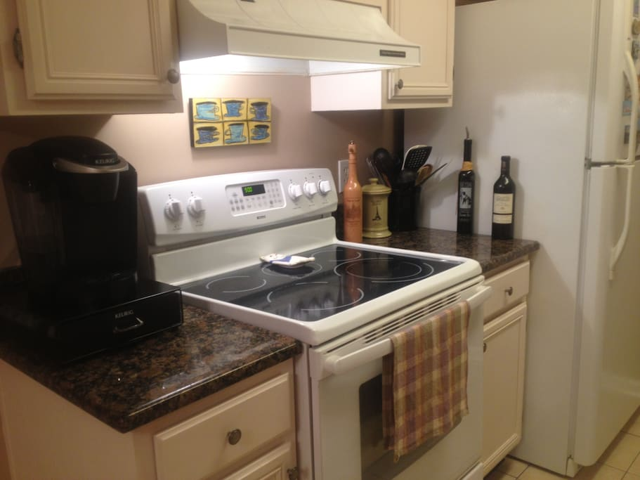 Fully equipped kitchen with Keurig coffee maker and convection oven.