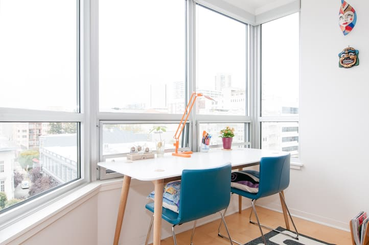 Large work station with a view in living room
